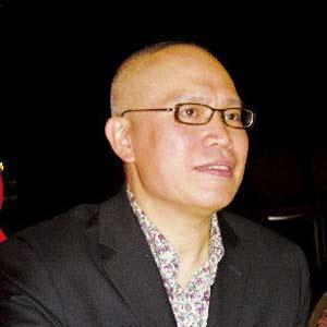 访美国龙年生肖邮票华裔设计师