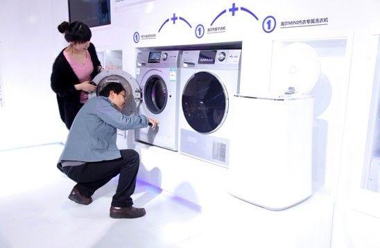 洗衣达人现场体验海尔洗衣干衣2+1组合